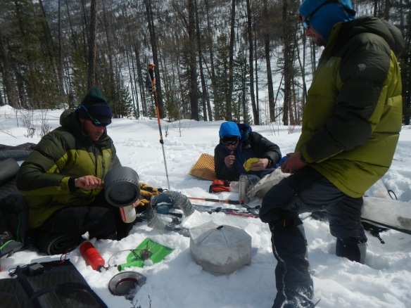 Jason, Jim, and Forrest taking a break at a wolverine track site, 2013.